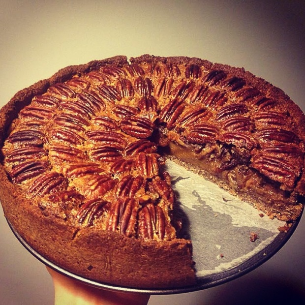 A full Paleo Pecan Pie with a slice missing