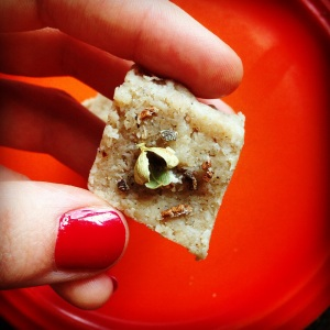 An overhead picture of a Paleo barfi diamond topped with an open cardamom pod