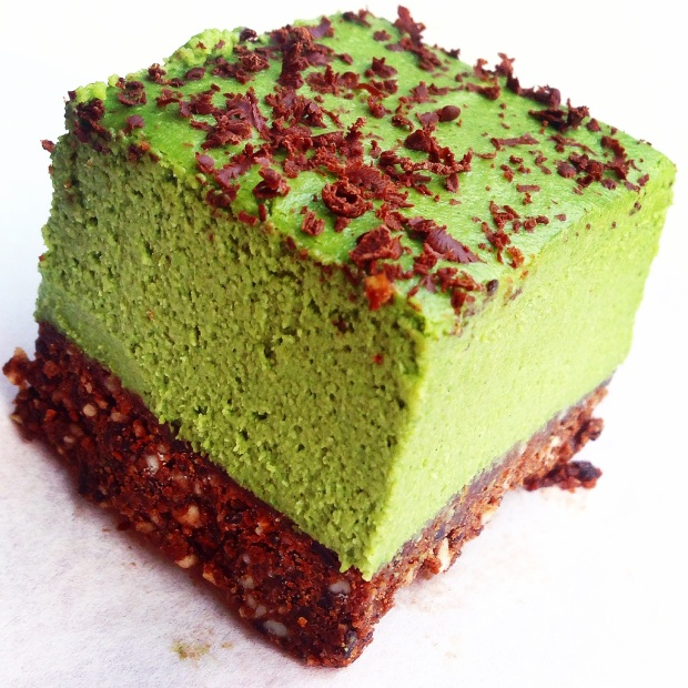 A close up angled shot of a Paleo Grasshopper Pie Cheesecake Square