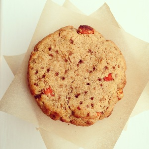 Overhead view of a stack of paleo goji berry and orange cookies