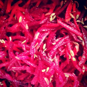 Close up of shredded beet, carrot & ginger salad with fennel seeds